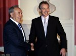 Disheartening: Tony Blair greets president of Kazakhstan Nursultan Nazarbayev, who is reported to have paid an astonishing $13¿million to hire him in 2011